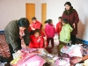 a-guide-a-teacher-helping-to-fit-winter-jacket-donated-by-steve-kim-at-guyon-ri-farm-dec-2005