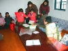 kindergarten-teachers-helping-students-trying-on-winter-coats-at-guyon-ri-dec-2005