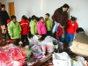 kindergartners-waring-winter-jackets-underwares-soaks-and-shoe-donated-by-steve-kim-dec-2005