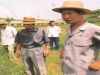 party-secretery-of-area-and-dir-of-daean-dairy-ranch-inspecting-forage-seed-performance-trial-planted-with-us-mn-grown-forage-seed-donated-by-agglobe-mission-1998