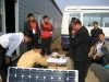 pres-choi-of-aram-in-sk-demonstrating-solar-energy-system-to-nk-engineers-officials-pyongyang-oct-2006